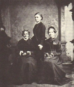 Elizabeth Ann Whitney, Emmeline B. Wells (standing), and Eliza R. Snow. They directed the work of Relief Society in the 1870s and 1880s. (From Women of Covenant)